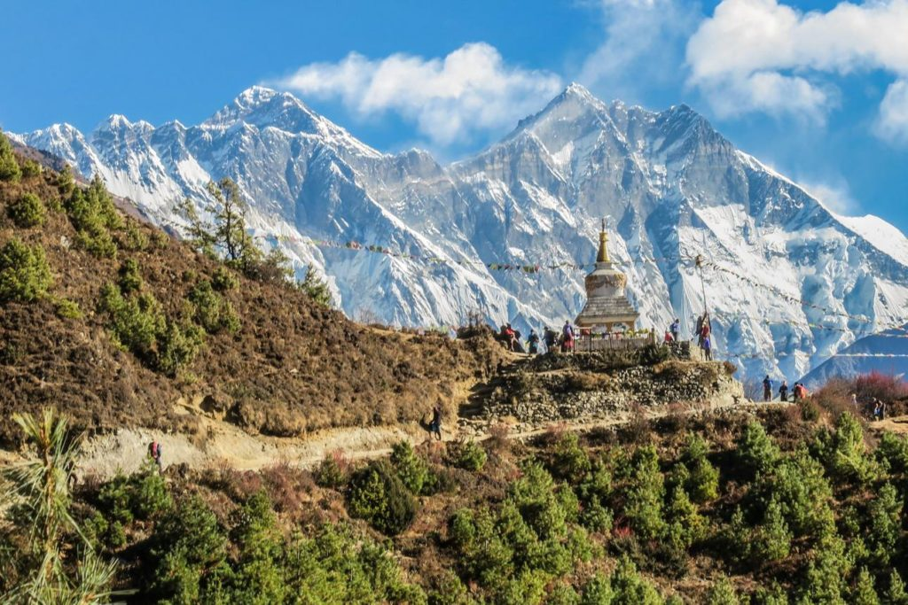 Stupa near Namche Bazar and Mount Everest, Lhotse south rock face - way to Everest base camp